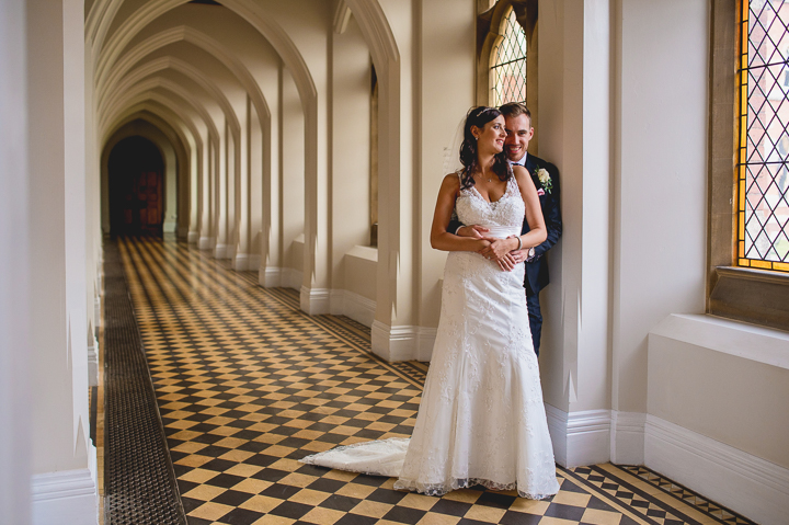 Bride and groom in the cloisters of Stanbrook Abbey in Worcestershire