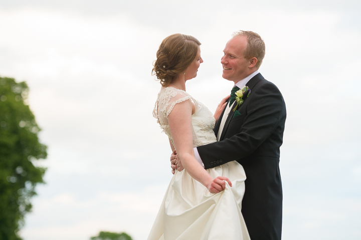 This wedding photo shows a bride and groom practicing before their first dance! The couple were married in Cotheridge, Worcestershire, and hosted their wedding reception at a family home in Worcestershire. Wedding photography by Lee Webb