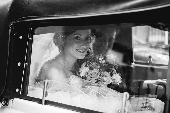 A bride arrives at Dumbleton Hall for her wedding
