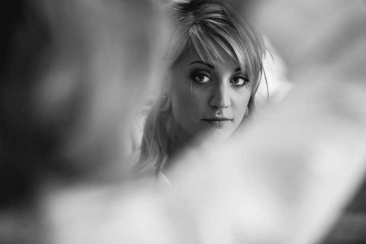 I love this wedding photo of the bride getting ready before her wedding at Mythe Barn in Athersone, Leicestershire. Photographing the bride before her wedding is one of my favourite times of the day. Wedding photography by Lee Webb