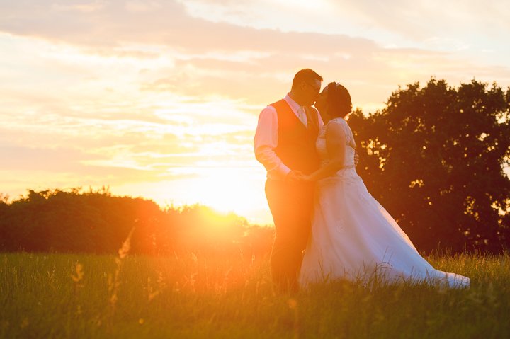 I photographed this beautiful wedding photo at The Pear Tree Inn at Smite in Worcester, Worcestershire. I took the photograph looking directly at the setting sun to give the image a golden glow. Been the wedding photographer for many weddings at the Pear Tree at Smite and it never fails to deliver in terms of location! A great Worcester wedding venue! Wedding photography by Lee Webb