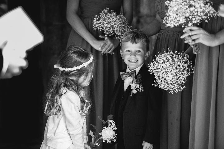 A young groomsman awaits the bride before the wedding