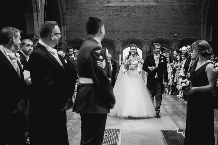 Worcestershire wedding photography. A bride and her father walk down the isle at St Georges Church in Worcester