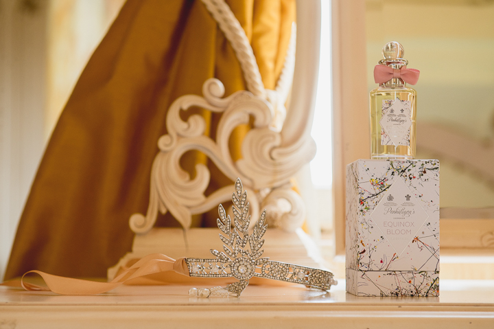 Tiara and wedding day perfume on a table in the bridal suite of Gosfield Hall in Essex