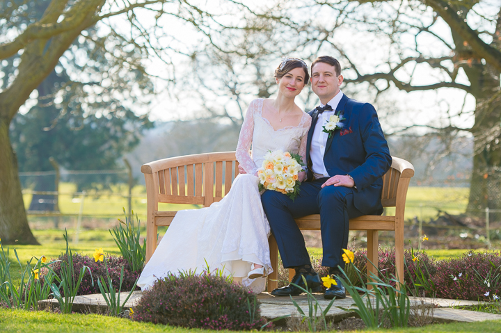 A bride and groom sit on a bench after their wedding at Gosfield Hall in Essex. It was a joy to be the wedding photographer at this wedding - Gosfield Hall offered up so many awesome opportunities! Wedding Photography by Lee Webb