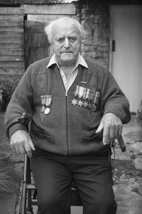 Herbert Fox wearing his and his father's medals, September 2014