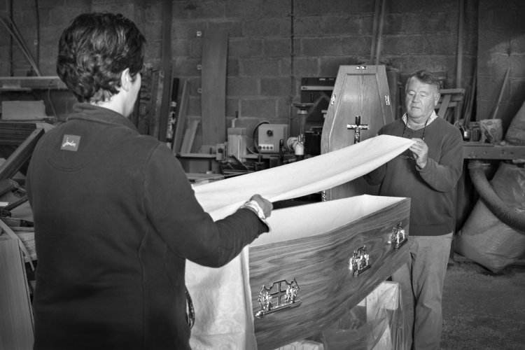 Nichola and her father John Thompson lining a coffin, September 2014