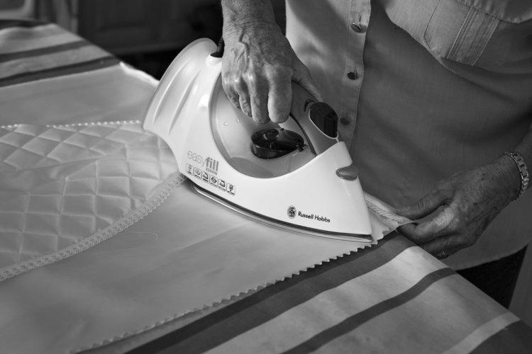 Barbara Thompson ironing a shroud, September 2014
