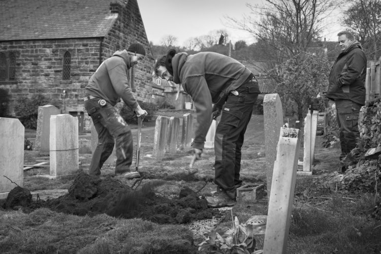 James Thompson with David Wallinger and Joe Casey digging a grave, St Benedict's Church, December 2017