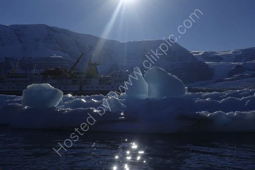 an impressive Iceberg Greenland  - see our ship behind it.