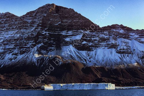 an impressive Iceberg Greenland  - see our ship dwarfed next to it.