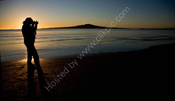 Rangitoto at Sunrise with  Photogrpaher