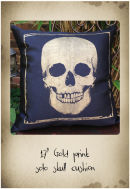 "17"" black cushion with gold skull print"