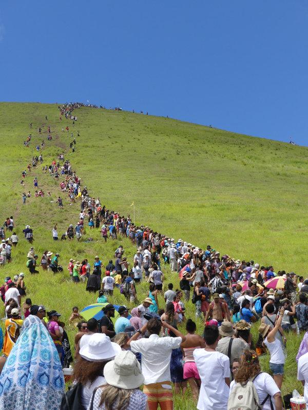 Haka Pei event - competitors race down slope on banana sled