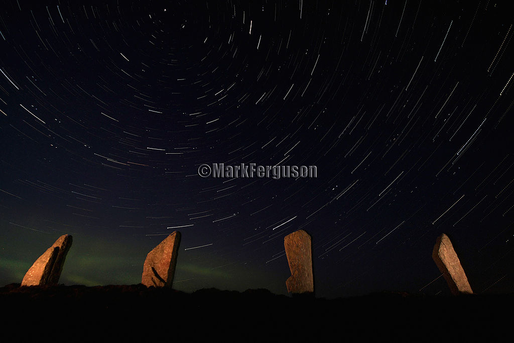 Ring of Brodgar startrails with auroral glow 2010