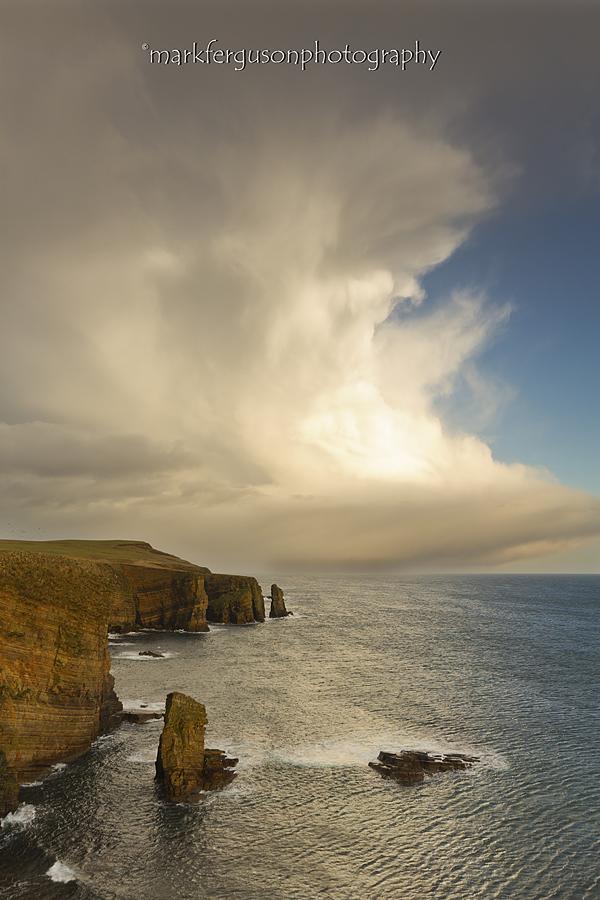 Cumulonimbus clouds near Wind Wick Bay