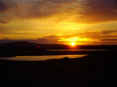 sunrise over benbecula from west coast road