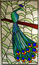 Stained glass peacock panel by Debbie Barker.