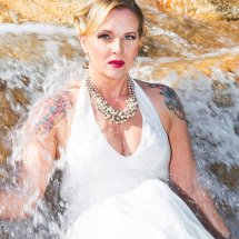 Bride in waterfall