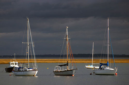 Boats against stormy sky
