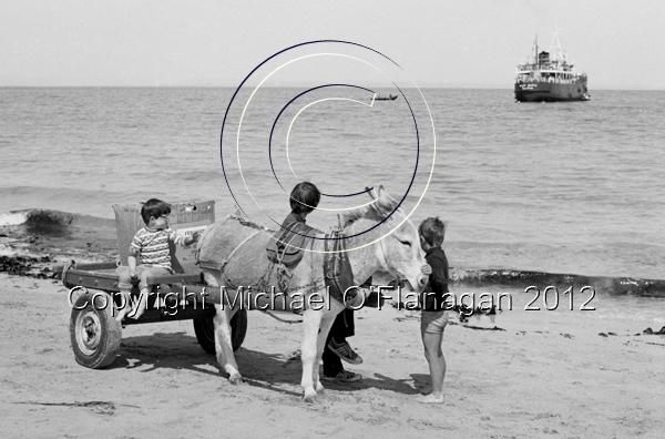 Ruairi O'Conghaile's Donkey & Cart & Naomh Eanna off-shore, Inis Oirr (1981) Ref. # F51.5a