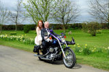 On the Harley.