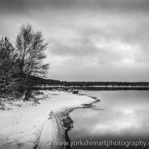 Loch Morlich in winter monochrome. Aviemore, Scotland UK