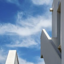White building, blue sky. Menorca