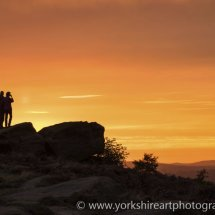 Man and woman at sunset. Otley Chevin, West Yorkshire, UK