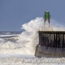 Storm waves breaking, Whitby harbour, North Yorkshire, UK