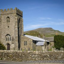 St Oswald's Church and Pen-y-Ghent. Horton in Ribblesdale, Yorkshire dales, UK