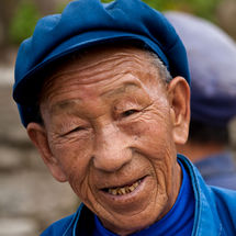 Baisha man with Mao cap