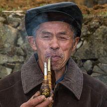 Smoking his cigarette
