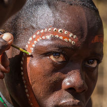 Bull jumping initiation ceremony - Painting his face
