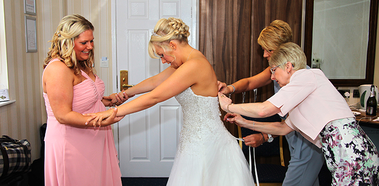 Getting in the dress!