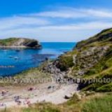 Lulworth Cove on the Jurassic Coast World Heritage Site in Dorset Panorama low tide clear wide vantage-
