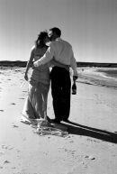 Wedding-Couple Stroll along Surf Bay.