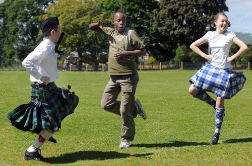 A Zulu Dancer learns the Highland Fling at Alness Academy