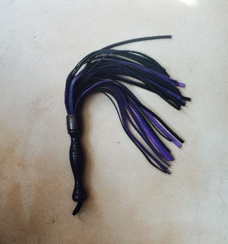 Purple and black leather whip from Jack's Floggers