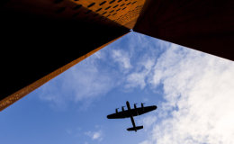 Lancaster passing the Lincolnshire Bomber Command Memorial