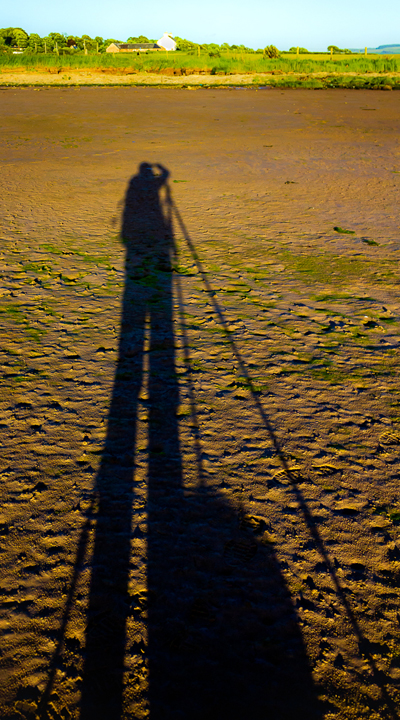 Tall photographer with tripod