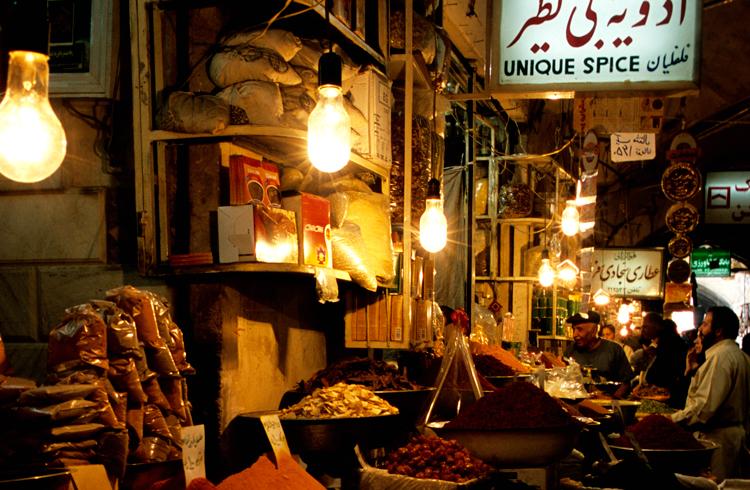 The spice market in the Bazar-é Bozorg bazaar. Photograph © Paul Bernhardt.