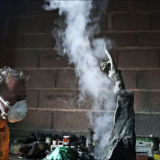 Fire and magic as Guillaume Couffignal works on the patination
