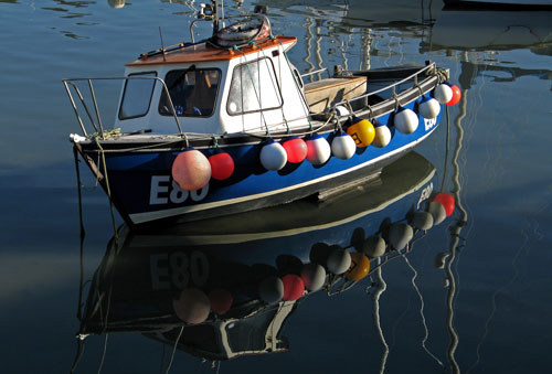 Boat reflections, Lyme Regis harbour