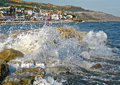Waves breaking in front of the beach at Lyme Regis, Dorset