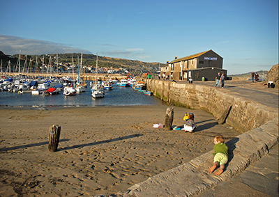 Lyme Regis harbour with boy