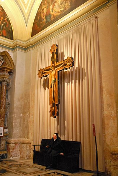 Nun waiting in cathedral in Valetta, Malta