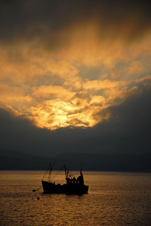 Sunrise with fishing boat