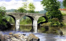 Old stone bridge over the river Viaur SW France.Watercolour