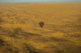 Shadow of Hot air Balloon over desert